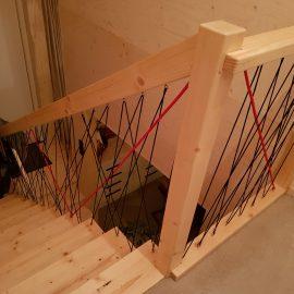 Gekleurd koord voor trapportaal